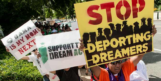 immigrants holding signs.jpg